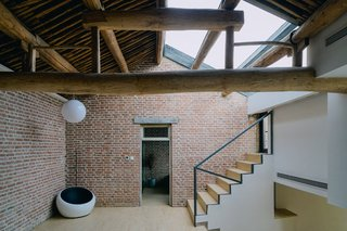 A skylight inset into the tiled roof brings light into the interior.