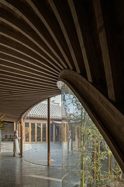 """""""The newly built veranda adopts a frame structure, with ribbed beams and panels on the ceiling, in order to maximize transparency and lightness as well as to better blend into the old construction,"""" says the firm."""