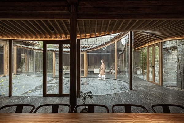 "The ""transparent veranda"" allows natural light to penetrate the building's interior and connects the living areas to the exterior courtyards."
