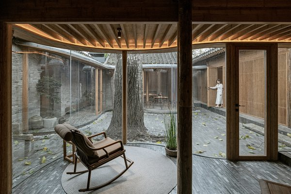 The walls of the veranda become much more markedly curved in the back courtyard. Two bedroom suites are made more private by the slatted screening.