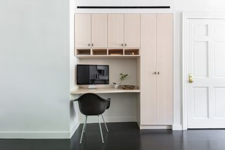 The built-in office nook is fashioned from whitened maple.