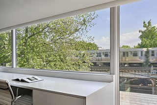 A designated work space overlooks the train tracks.