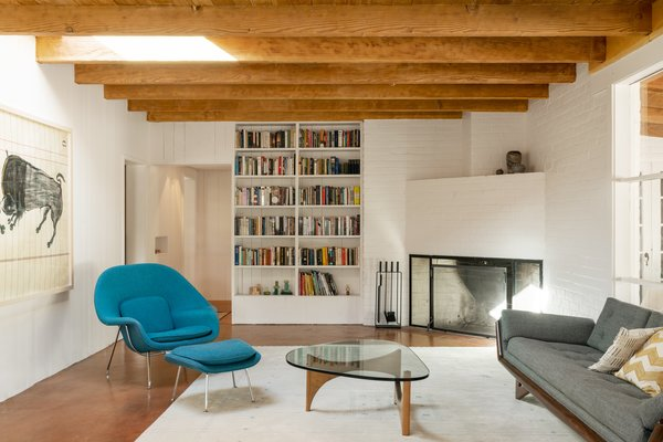 The Adrian Pearsall sofa was sourced from The Swanky Abode on 1st Dibs, and the fire tools are also from the Sunshine Shop, a local vintage store.