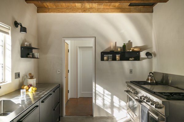 """""""In the kitchen we wanted to create an austere volume filled with natural light that allows for a small room to feel so much bigger,"""" says Hazelbaker."""