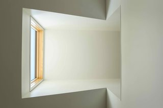 The new dormer acts as a skylight for the living room, and also brings light to the upper level, thanks to a cut-out in the hallway.