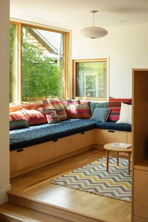 A cantilevered addition creates more space for the kitchen and pantry, as well as this cozy new family nook.