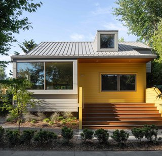 Now the facade is distinguished by bright yellow and soft gray paint, and oversize windows.