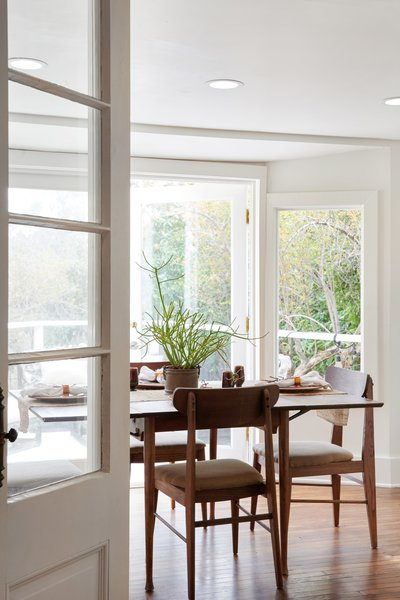 A set of salvaged doors helps to separate the dining area acoustically, if needed.