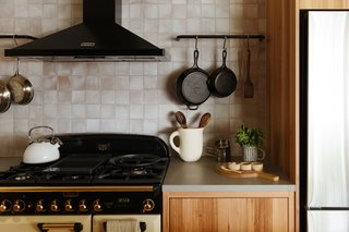 Custom metal rails suspend cooking implements within easy reach.