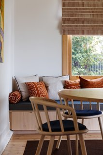 A whitewashed oak bench installed under the window provides additional seating and storage.
