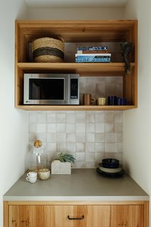 The pantry provides more storage and allows clutter or small appliances to be stashed away.
