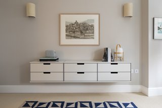Wall-mounted storage also provides a place for everything while reducing visual clutter.