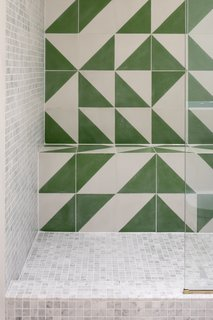 The shower seat cleverly repurposes an original (but already blocked out) chimney breast recess.