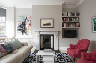 Astrain updated the fireplace with a Carrara marble Victorian fireplace surround from The Architectural Forum.