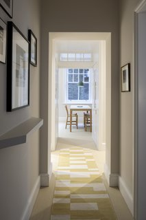 Now, the view from the front door is into the dining area. Note the angled shelf at the entry, a geometric detail which will be a reoccurring motif throughout.