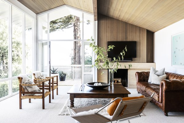 """Existing windows were replaced with Loewen wood-clad units. The team also sanded and lightened the cedar paneling. """"We liked that original tone of the cedar and just lightened it up to look more modern and airy,"""" says Wittman."""