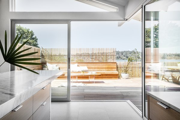 """We moved the column supporting that whole roof,"" says Wittman. ""It looks simple, but it was a lot of work."" Now, two large, aluminum multi-slide doors from LaCantina open up the entire corner."