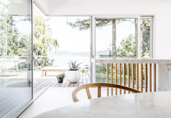 The view from the nook to Lake Washington. The slat screen at the end of the island creates visual consistency with the revamped deck, and the glass guardrail doesn't obstruct views.