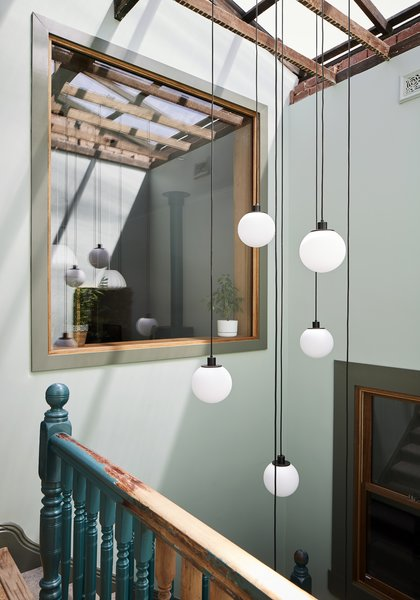 A large interior window allows light to reach the main living spaces.
