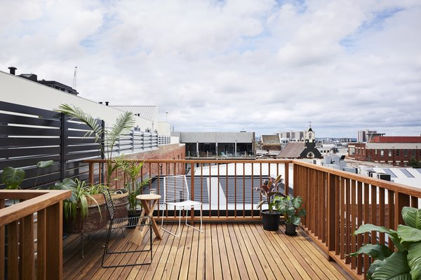 A brand-new rooftop deck gives the owners a private outdoor spot to lounge, entertain, and take in views of the city.