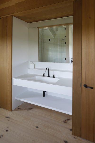 Wood paneling balances the crisp, white fixtures.
