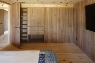 Continuing the built-in elements and panelling in the bedrooms creates visual consistency and eschews the need for additional furniture that may bring clutter.