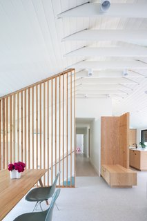 A coat of white paint lightens up the scheme, as do the polished travertine floor tiles.