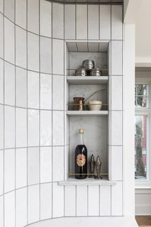 The walls were gently rounded at the stove alcove and inset niches hold supplies.