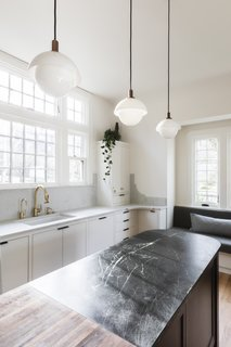 """Removing the dropped ceilings had a dramatic effect on the perceived size of the room. """"I think the ceiling height alone changed how that space felt,"""" says Dyer."""