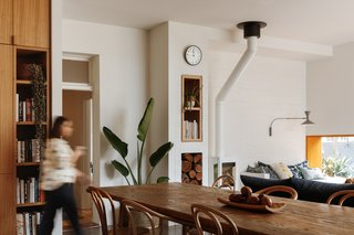 The former exterior wall is now a textural accent in the living room that syncs with the concrete wall in the kitchen.