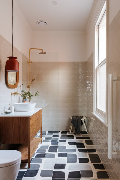 The floor tiles are from Popham Design in a custom palette, paired with handmade subway tile in an earthy, off-white color.