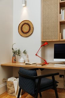 A built-in desk makes good use of the small footprint in the study.