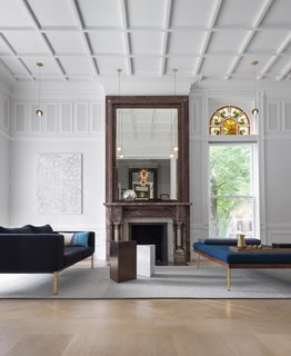 "With regards to the woodwork, ""all of the new stuff that we added all have modern profiles,"" says Rausch, but their application recalls the home's traditional roots. White paint marries new and old."