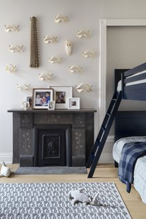 The fireplace was relocated to this bedroom so as to preserve it and make it a feature.