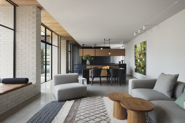 Moloney Architects unified the home's interior and exterior by strategically applying materials. The oak at the interior ceiling continues on the exterior, as does the white brick. The thin profile of the steel around the windows and doors completes the effect.