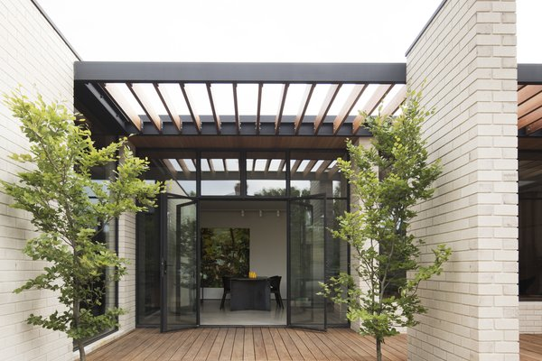 A wood pergola offers coverage while allowing light to filter inside.