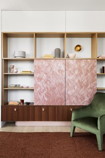 Sliding doors crafted from Marblo conceal the television