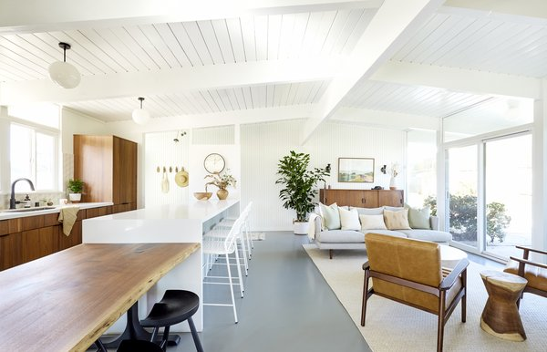 """""""The clients' main priorities in their lives consisted of: their kids, their friends, their food,"""" says the firm. """"We knew we had to knock down the wall that separated the kitchen from the living room to create one big, open space - this immediately created ease of flow."""""""