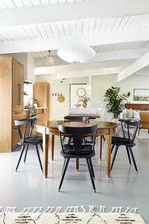 The dining table is a family heirloom surrounded by Ripley Dining Chairs from Four Hands.