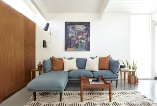 "The Floyd sofa was chosen to jive with the family's vintage painting, called the ""Jazz Musician."""
