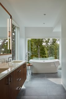 The bathroom floor is covered in Porcelanosa Boston Stone.