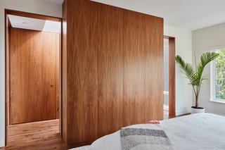 All of the home's walnut cabinetry is book-matched, so the grain flows across the fronts.