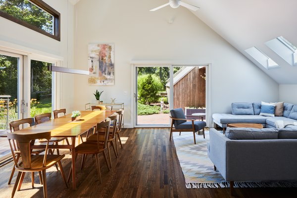 New flooring—oak with a walnut stain—connects the living spaces throughout.
