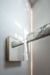 """""""A structural beam above the foyer was retained, which witnessed renewal of the space and carries its past memories,"""" says the firm. """"The box beside the beam features a mirror surface, which reflects it and seems to blur...the relationship between the old and new."""""""