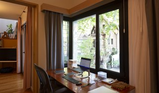A desk sits in the revitalized window niche.