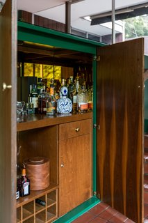 A bar is tucked away in a living area built-in.