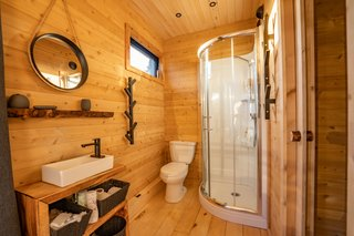 "There are 1.5 bathrooms in the home, and the upstairs en-suite bath has the shower. ""Although very well equipped with solar energy, you must manage energy according to the power of the sun,"" says Dignard. ""In winter, taking six showers one after the other is not so much 'smart energy.'"""