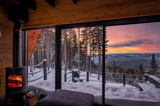 The sky view from the living room couch. The home is warmed by a propane heater and wood stove in winter.