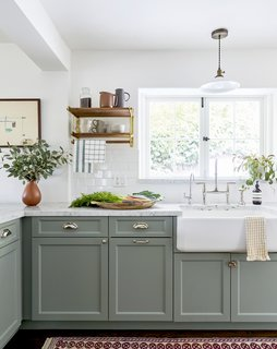 The existing cabinets were painted Card Room Green by Farrow & Ball.