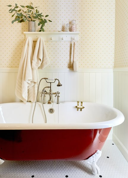 A cast-iron clawfoot tub from Vintage Tub & Bath received a bold red paint job.